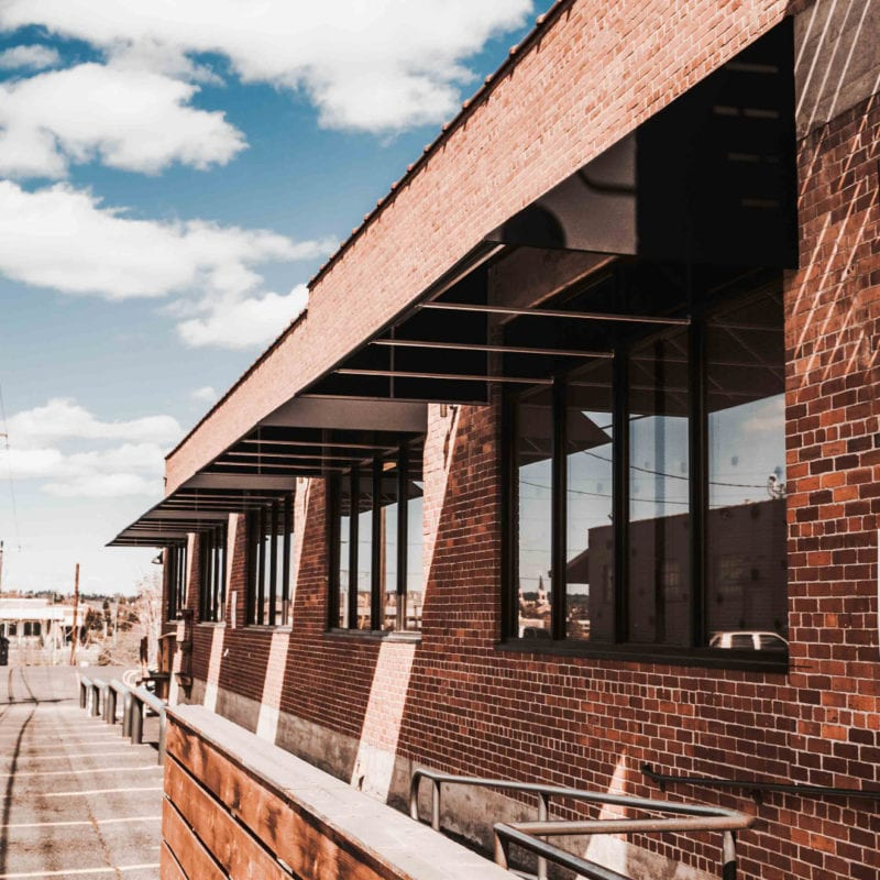 Aluminum Awnings Commercial Brick Building